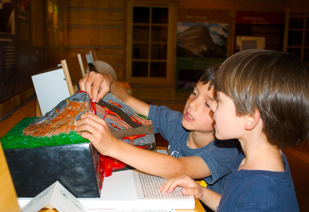 Children learn about volcanoes in the Draper Museum of Natural History