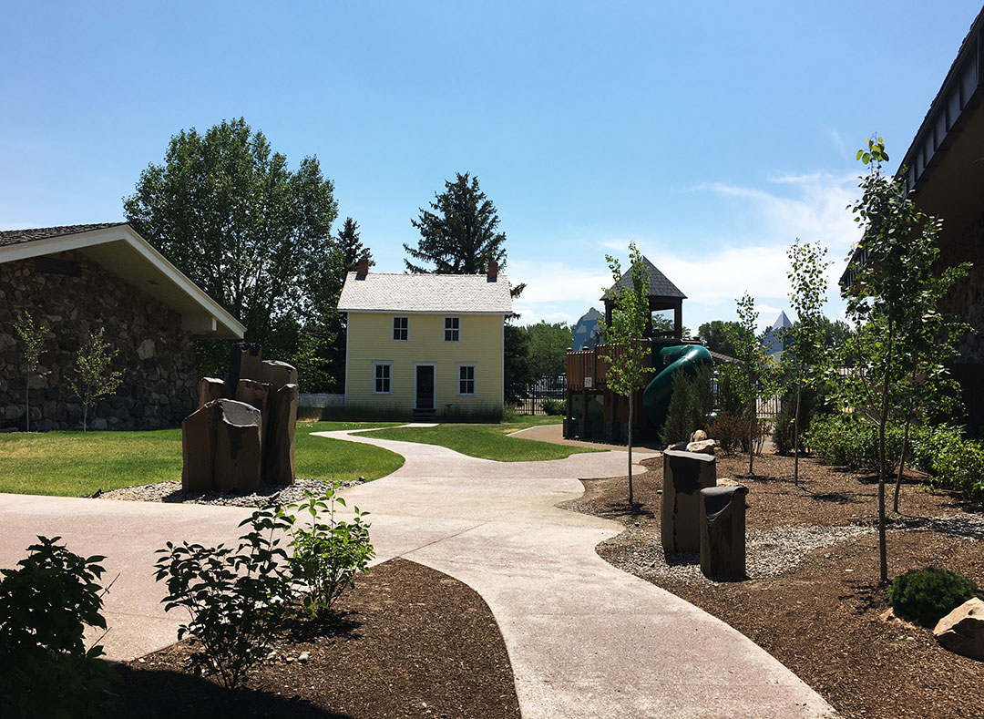 Cashman Greever Garden with boyhood home and play area.