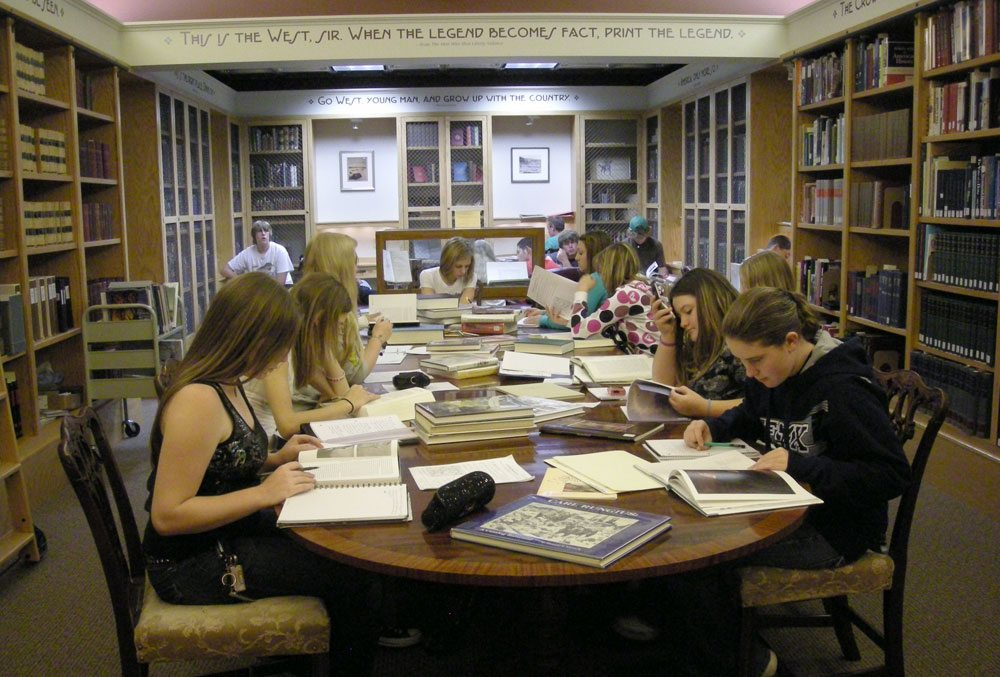 Area high school researchers in the library's reading room