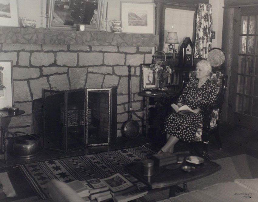 Mary Jester Allen in front of the fireplace in the Buffalo Bill Museum, 1953. Mrs. Allen actually lived in the museum from the time of its construction until her death in 1960. Mary Jester Allen Collection. P.69.570