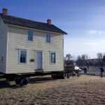 The Boyhood Home on a flatbed, moving the 100 yards to the Greever Garden.