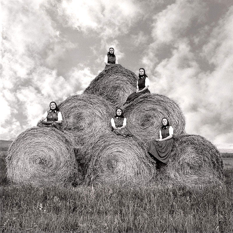 Laura Wilson. Hutterite Girls During Hay Making Season, Surprise Creek Colony, Stanford, Montana, August 22, 1991. Gelatin silver print, 40 x 40 in. Private Collection.