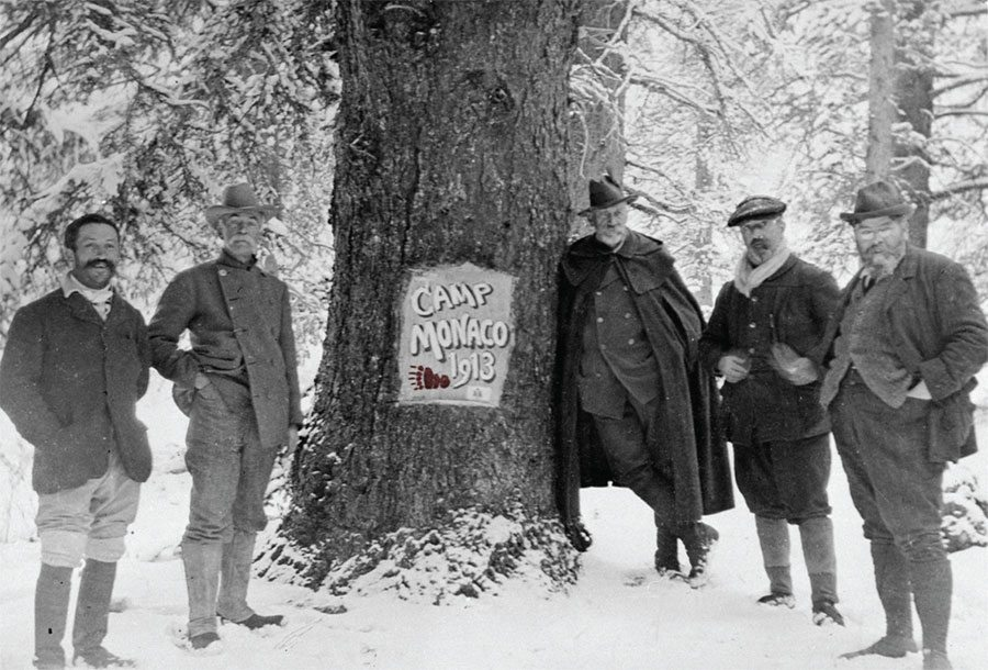 Camp Monaco, 1913, with Prince Albert I of Monaco leaning on tree. PN.89.16.2726.12