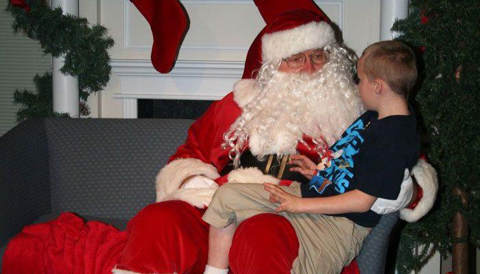 Santa visits with a hopeful child