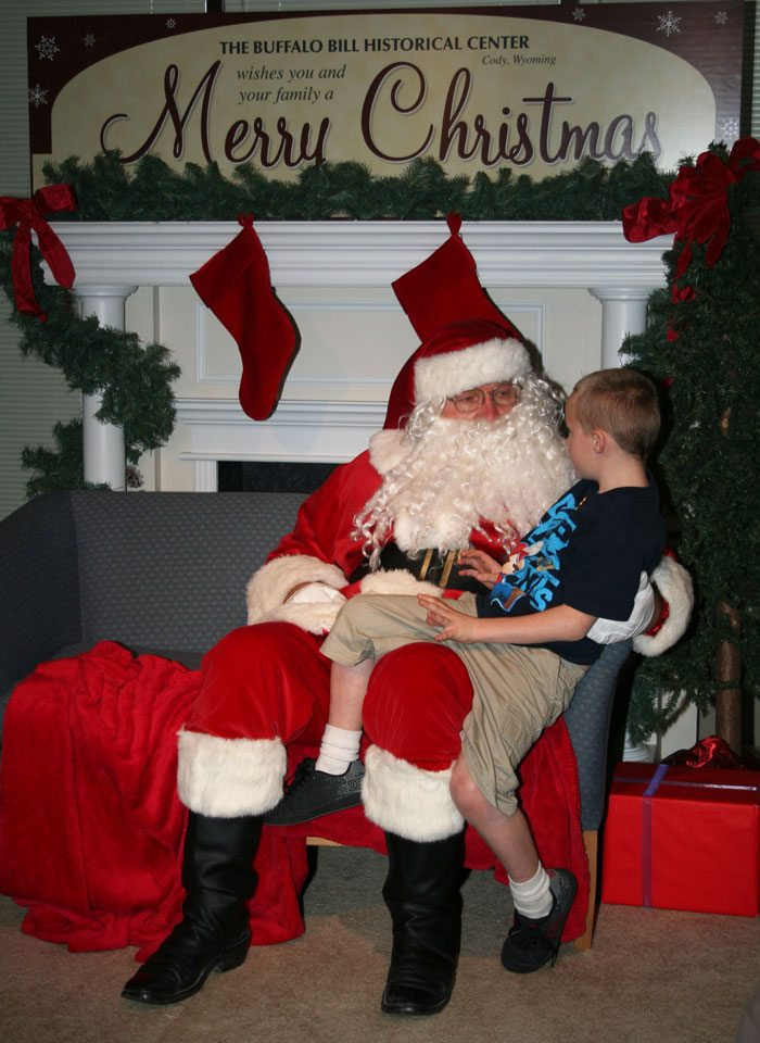 Santa visits with a hopeful child