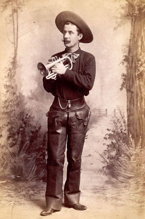 Band leader of Buffalo Bill's Cowboy Band, William Sweeney, in uniform with cornet, ca. 1887. Cabinet photograph. Gift of Mr. and Mrs. George Strobel. P.6.55