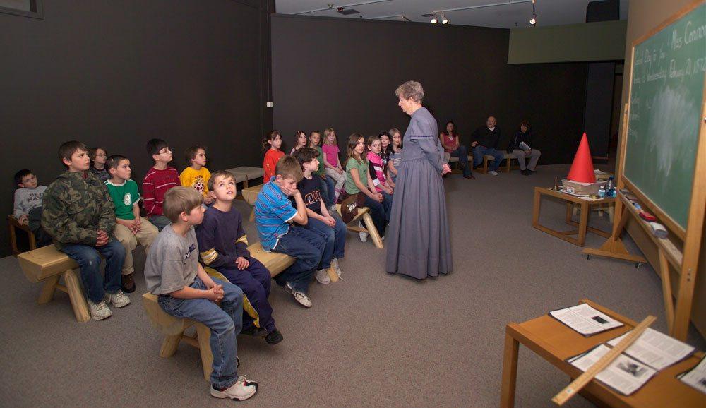 Students learn about school in earlier times