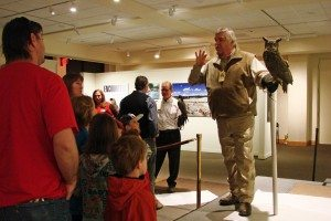 Bud telling our visitors about Teasdale, our great-horned owl.