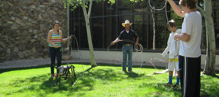 Fledgling ropers learn a thing or two from a cowboy from Buffalo Bill's Horse World at the 2012 National Day of the American Cowboy Family Fun Day