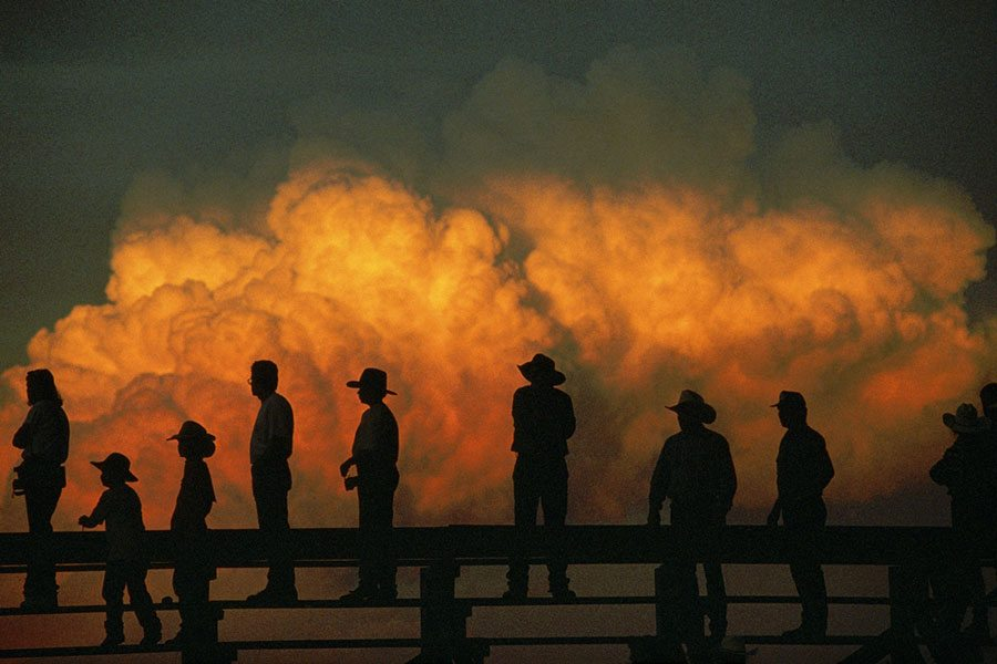 Stormy skies at a rodeo in Nebraska, 1998. Joel Sartore/National Geographic Stock.