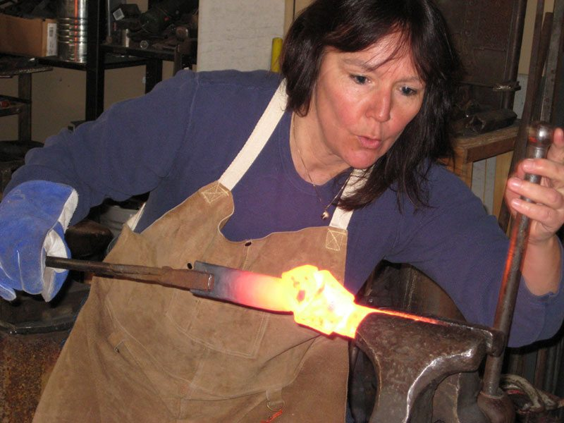 Annette Lavalette and three fellow blacksmiths demonstrate their art August 16–18, 2013.