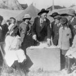 Buffalo Bill with children and birthday cake. MS304