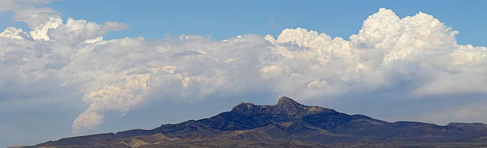 Heart Mountain under the clouds. Photo by Mack Frost.
