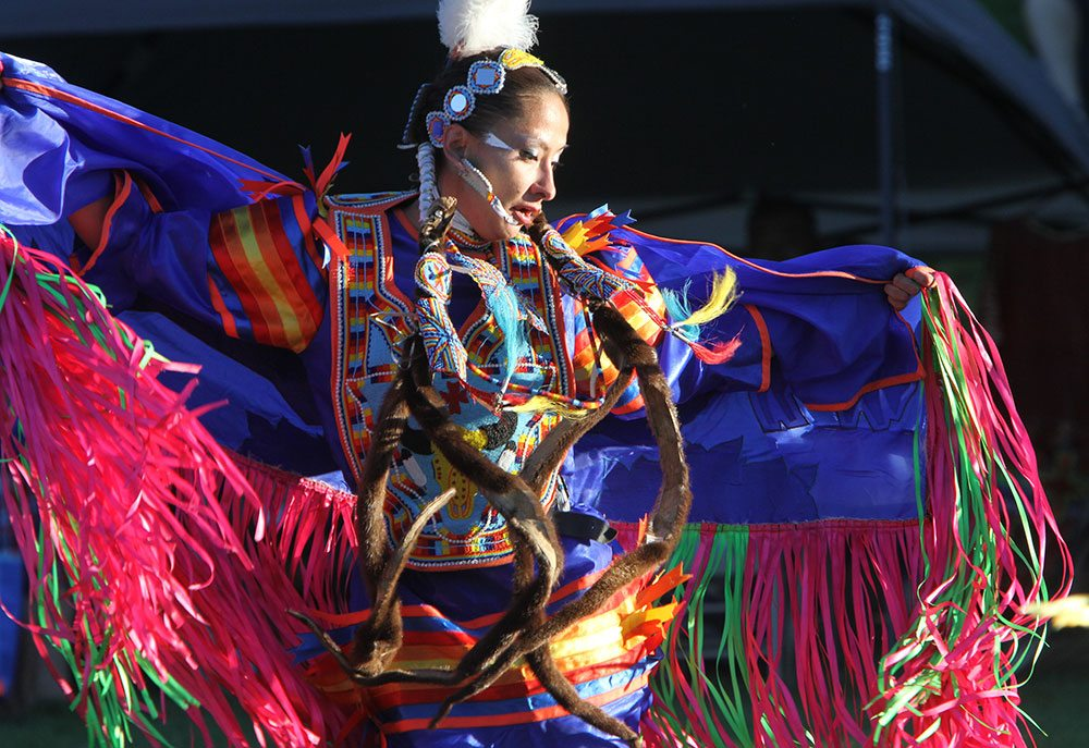 Plains Indian Museum Powwow fancy shawl dancer, 2013. Photo by Ken Blackbird.