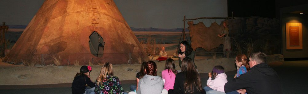 Students on a guided tour learn about Plains Indian culture