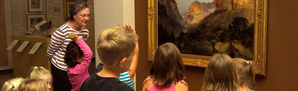 A docent-led school tour in the Whitney Western Art Museum