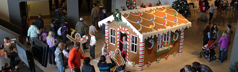 A life-sized 'gingerbread house' is a popular stop at the Center's annual Holiday Open House