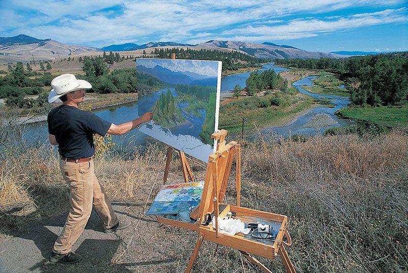 Artist Charles Fritz painting near Travelers Rest.