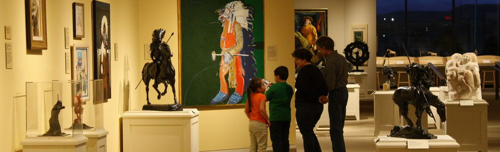 A family tours the Whitney Western Art Museum at an event
