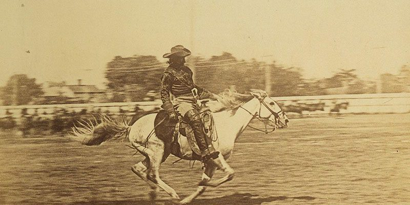 Cody liked riding at full speed. In this undated photo, he races his horse in an arena. Vincent Mercaldo Collection. P.71.40.1