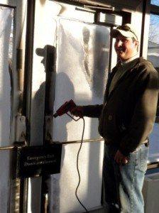 Maintenance worker melting ice on the locks.
