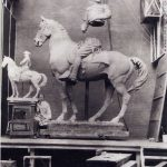 Alexander Phimister Proctor in his studio with the sculpture, Rough Rider, 1922.
