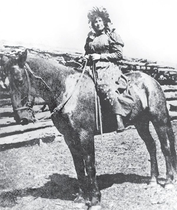 """Ella """"Cattle Kate"""" Watson on horseback. Wyoming State Archives, Department of State Parks and Cultural Resources. Sub Neg 4104"""