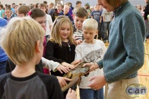 LaDaun showing students a pheasant skin after a program.