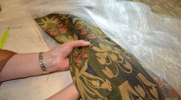 Repair of tapestry by hand sewing