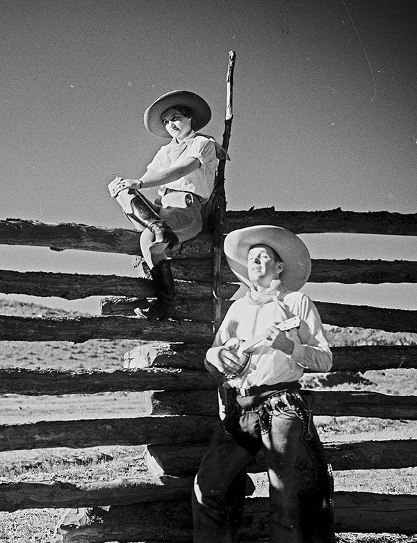Charles Belden photo of a cowboy serenading a cowgirl, ca. 1930s. MS3 Charles Belden Collection. PN.67.799