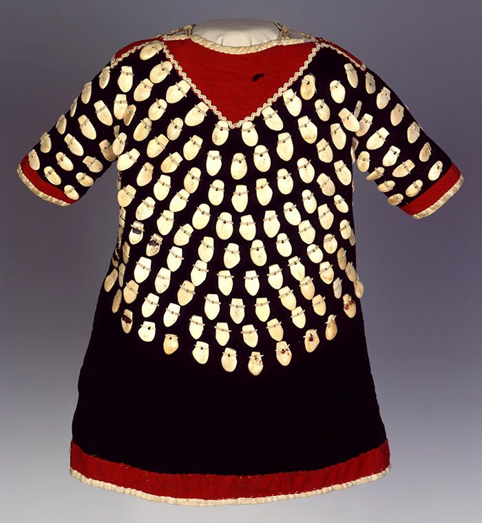 "Crow dress with adornment of bone carved to look like elk teeth. Irving H. ""Larry"" Larom Collection. NA.202.881"
