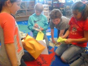 Several of Ms. Krejci's students counting the money they had raised.