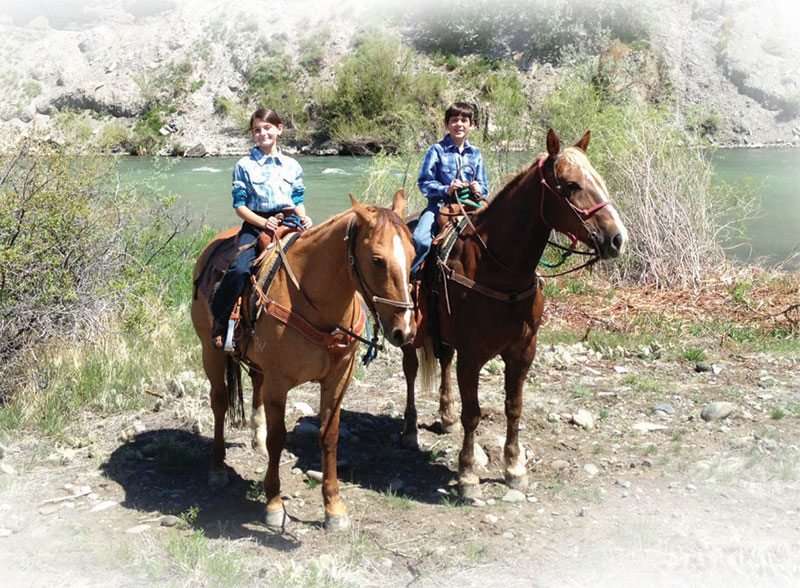 Kids on horseback by Shoshone River.