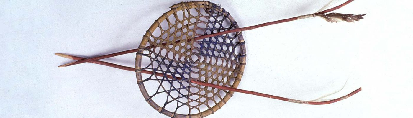 Hoop and arrows. Sioux, Northern Plains. Wood, rawhide thongs, red paint, blue paint, yellow paint, horse hair, and feathers. Royal B. Hassrick Indian Collection. NA.503.5A-C