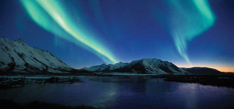 """Florian Schultz's Northern Lights photo from """"Yellowstone to Yukon"""" exhibition."""