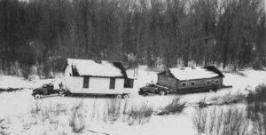 Moving houses from Elbowoods, North Dakota, across the frozen Missouri River. Image courtesy of Marilyn Cross Hudson.