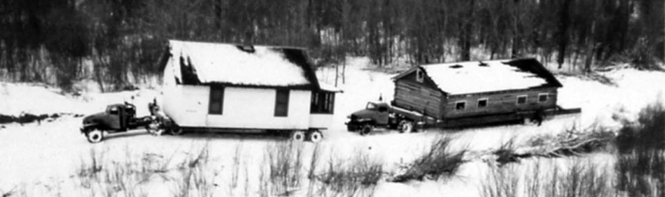 Moving houses from Elbowoods, North Dakota, across the frozen Missouri River. Image courtesy of Marilyn Cross Hudson.