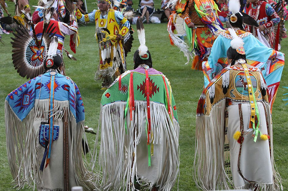 Dancers in traditional dance regalia at the Plains Indian Museum Powwow. Photo by Ken Blackbird.