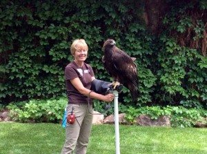 Woman holding golden eagle.