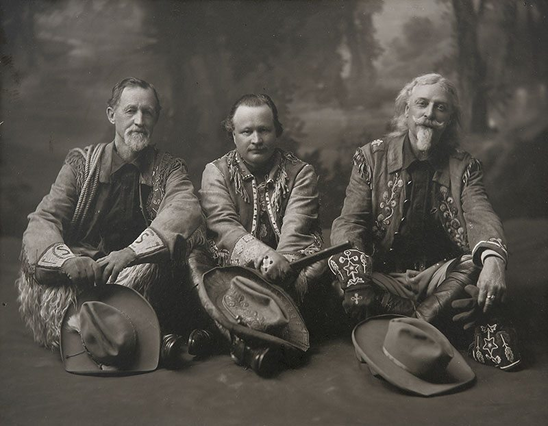 """Captain Jack Crawford, Pawnee Bill and William F. """"Buffalo Bill"""" Cody in their Wild West show dress, ca. 1911. Original Buffalo Bill Museum Collection. P.69.1084"""