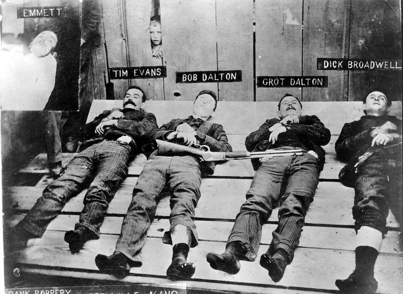 The Dalton Gang, deceased bodies on display in Coffeyville, Kansas, following their ill-fated attempt to rob two banks there simultaneously on October 5, 1892. MS 71 Vincent Mercaldo Collection. P.71.1166