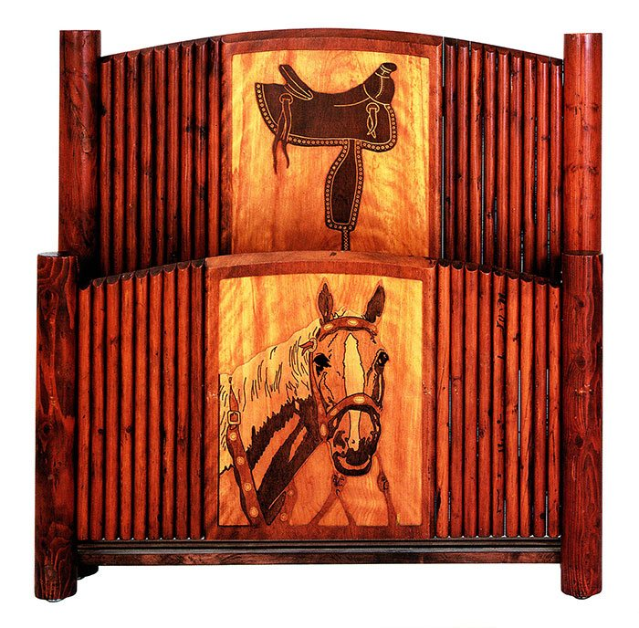 One of a set of twin beds, this hardwood-panel and pole-trim bedstead features a routed saddle design on the headboard and an intricately routed and stained horse's head on the footboard. Courtesy James E. Nielson