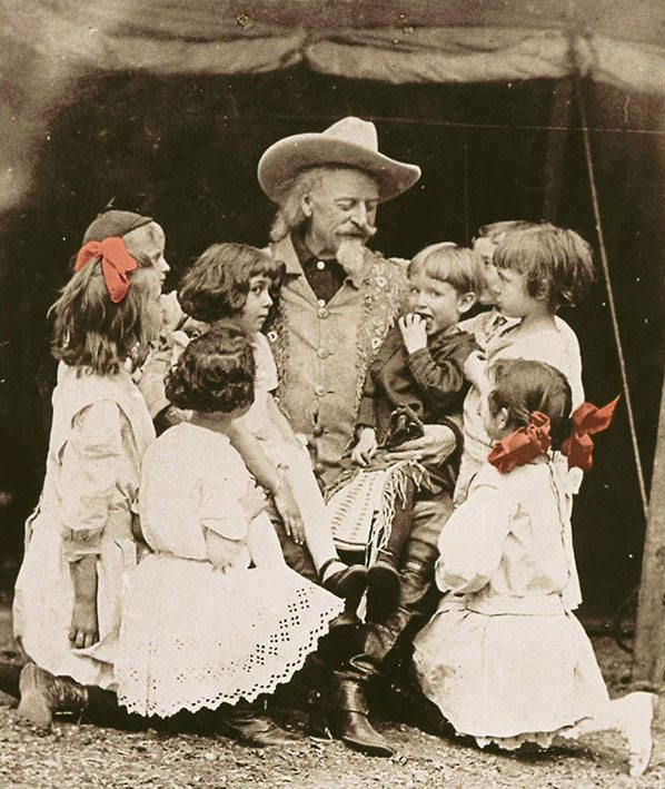 "Buffalo Bill loved children and was brokenhearted at the plight of the widow's ""tots,"" saying, ""You could have felled me with a feather the next moment, when I heard the sweet, soft voice of a little child - it was two long years since I'd last heard one…"" Vincent Mercaldo Collection. P.71.1459. (Colorized)"