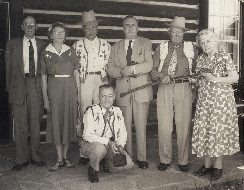 Cody family members as well as the general public donated materials to the Buffalo Bill Museum. Here, Harvey P. Cody presents Ned Buntline's Civil War sword to Mary Jester Allen at the 1953 Cody Family Reunion. Present are, left to right, Dr. and Mrs. Frank McClanahan, Hiram S. Cody, Ernest W. Cody, Harvey P. Cody, Mary Jester Allen, and Joe Hufford (kneeling). Jack Richard Photo. Mary Jester Allen Collection. P.41.501