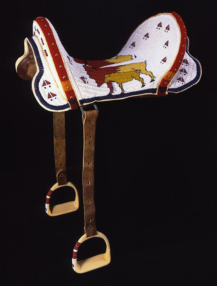 Beaded Saddle, Marcus Dewey, Northern Arapaho, Thermopolis, Wyoming, 1997. Tanned hide, glass beads, wool cloth, brass tacks, and McClellan saddle. Museum purchase with Funds provided by the Pilot Foundation. NA.403.203