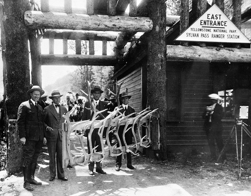 Black and white photograph by Jack Richard (1909 – 1992). Yellowstone National Park Superintendent Horace Albright at the East Gate to the Park on season opening day, June 15, 1915. MS 89 Jack Richard Photograph Collection. PN.89.116.21440.4