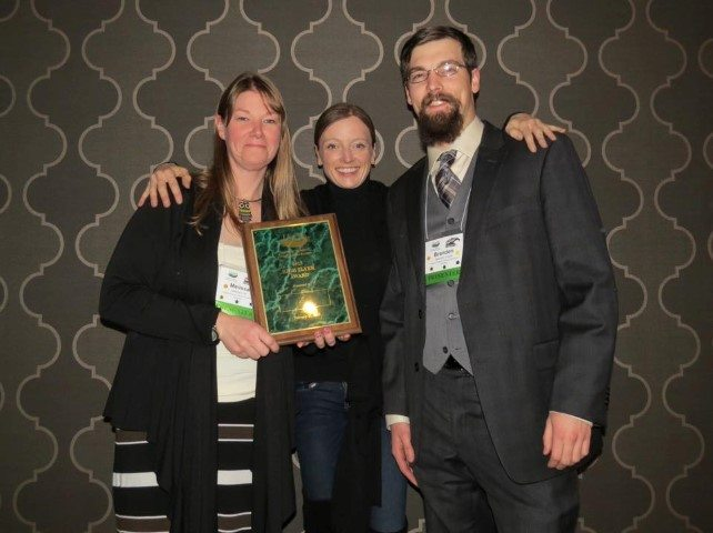 Melissa and Brandon accept the High Flyer Award present by Helen Dishaw, VP of IAATE.