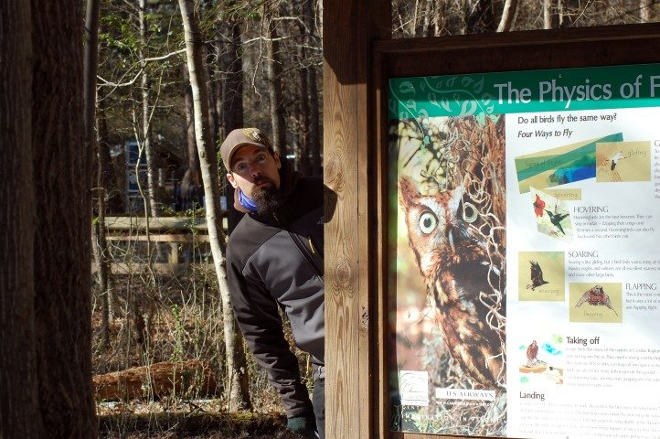 Brandon was definitely liking the signs at the Carolina Raptor Center.
