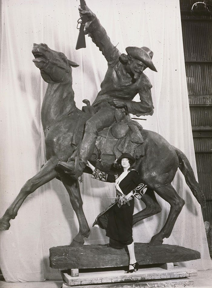 Before it traveled to Wyoming, Whitney posed with her sculpture of Cody, ca. 1923. Original Buffalo Bill Museum Collection photo. P.69.185