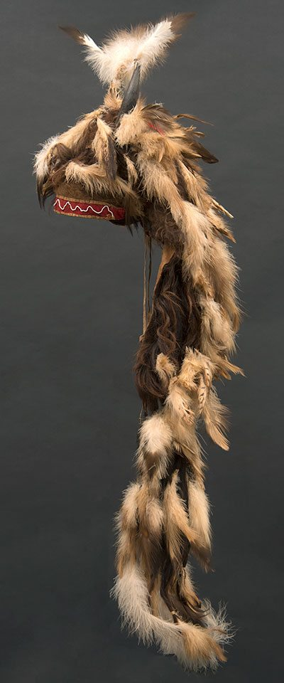 Motokiks Society buffalo horn bonnet including buffalo horns, hide, and hair; golden eagle and hawk feathers. Blackfoot-Kainai, Canada, ca. 1860. Paul Dyck Plains Indian Buffalo Culture Collection. NA.205.109